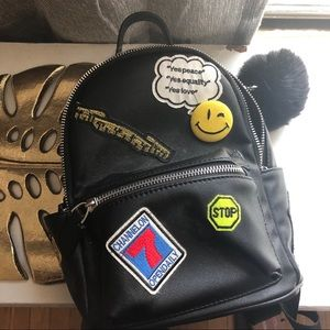 3558760b094fc0 Marshalls. Black backpack with patches
